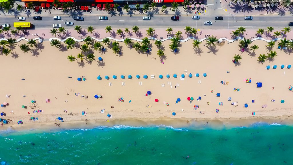 an aerial view of people on a beach - one of the fun things to do in Fort Lauderdale