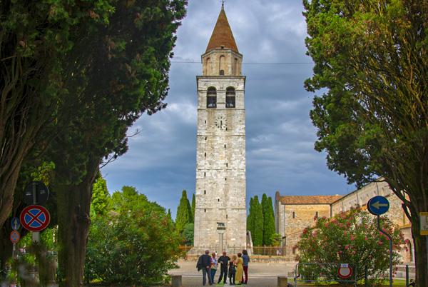 people by a bell tower in Friuli Venezia Giulia