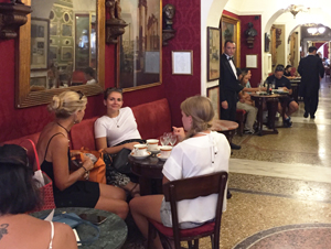 women in a coffee shop seen on walks in Rome