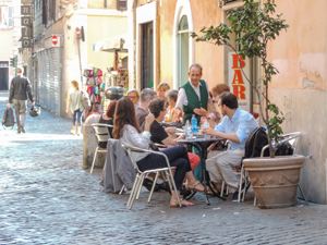 people in an outdoor restaurant seen on walks in Rome