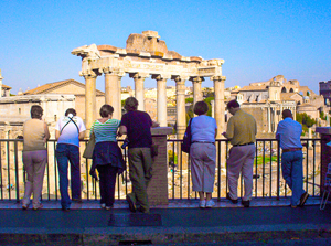 people looking an ancient ruins during walks in Rome