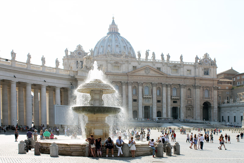 a fountain in front of St . Peter's Basilica seen on walks in Rome