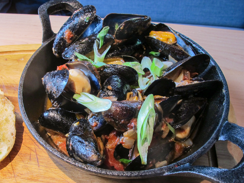 mussels in a pot at a restaurant
