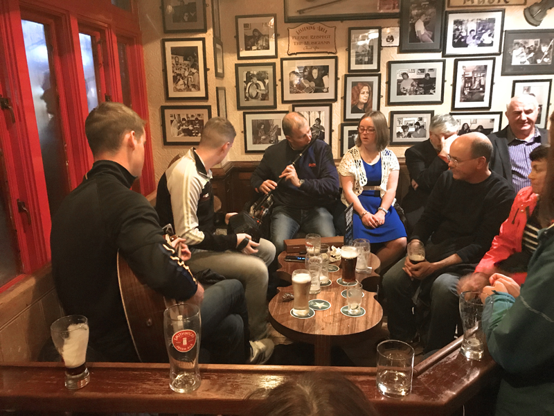 People listening to music in a pub, one of the things to do in Europe