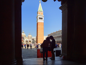 a bell tower in a square, one of the things to see in Europe