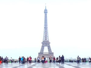 people by the Eiffel Tower, one of the things to do in Europe
