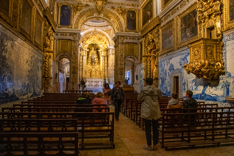 people sitting in a church, one of the things to do in Europe