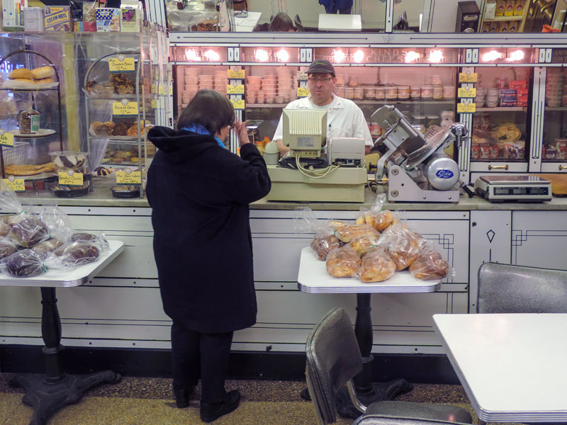 a woman buying food in one of the delis in New York City