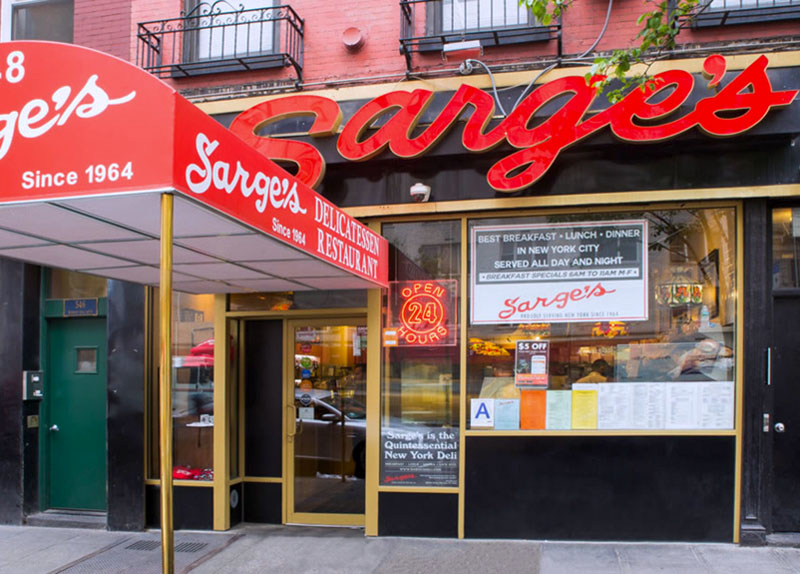 a red sign for Sarge's, one of the delis in New York City