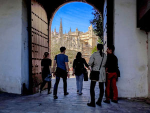 people in a doorway near a cathedral