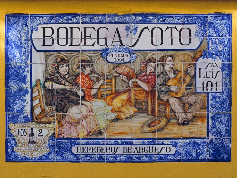 a colorful tile sign for a bodega