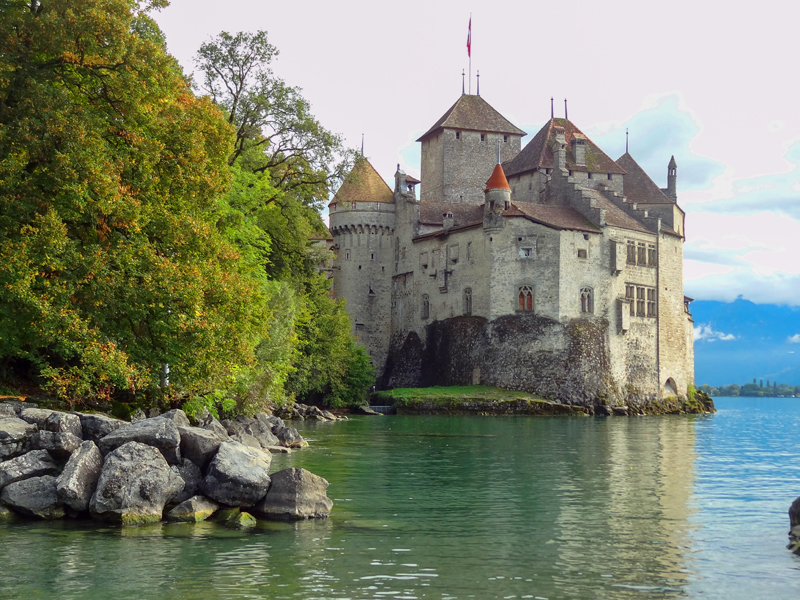 a castle on a lake in Montreux Switzerland