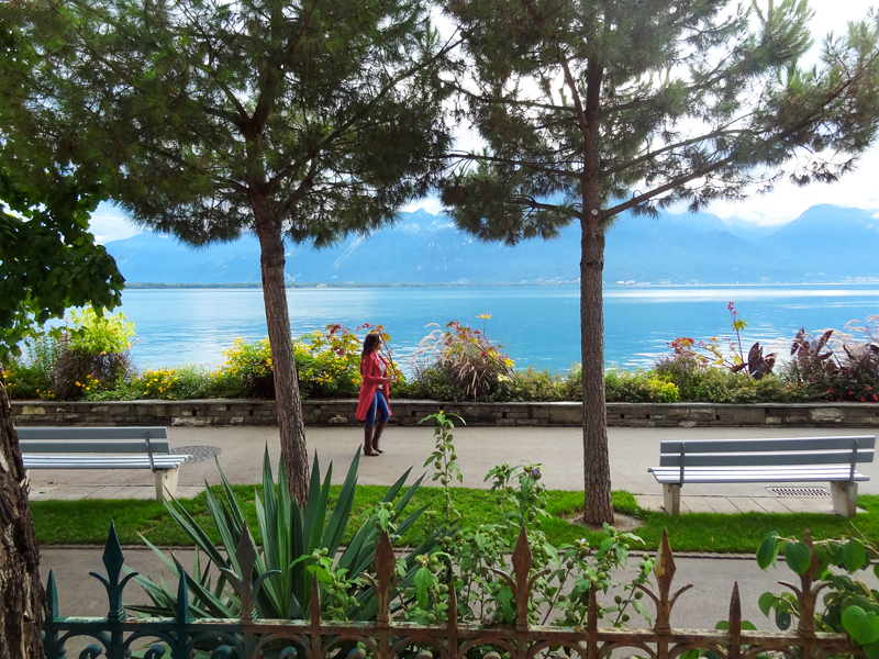a woman walking along a lake in Montreux Switzerland