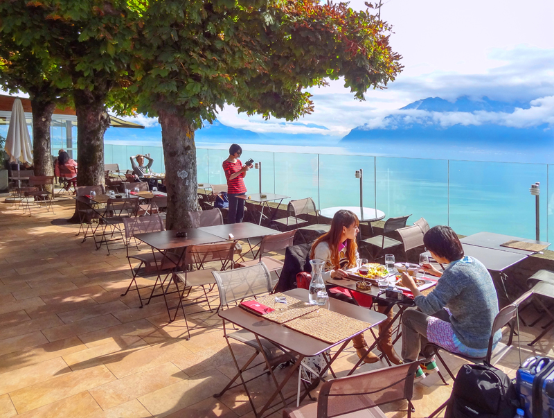 people dining near a lake in Montreux Switzerland