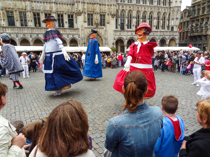 a festival with tall puppets in  one of the places to visit in Belgium