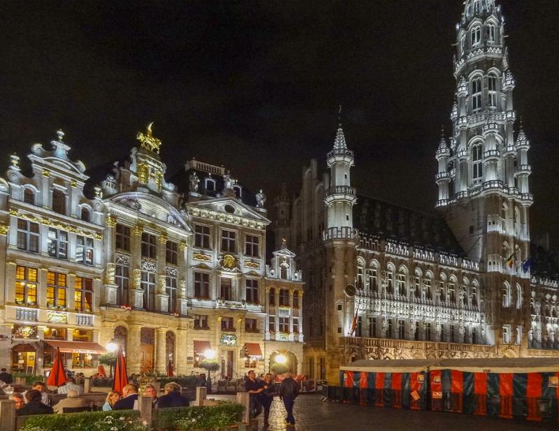 an ornate square at night in one of the places to visit in Belgium