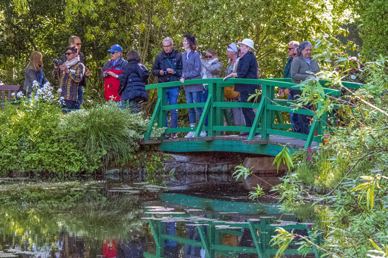 people on a bridge seen in Monet House and Gardens