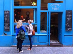 women outside a shop painted blue