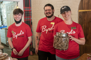 the staff of a cookie store in red shirts