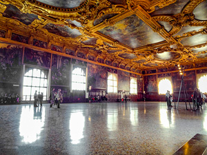 a large room with a very ornate ceiling in one of the best places to visit in Venice
