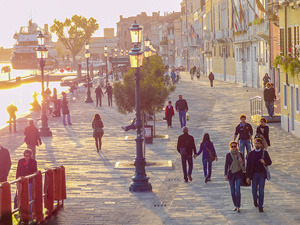 people walking along a broad walkway in one of the best places to visit in Venice