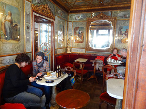 people in an ornate cafe room in one of the best places to visit in Venice