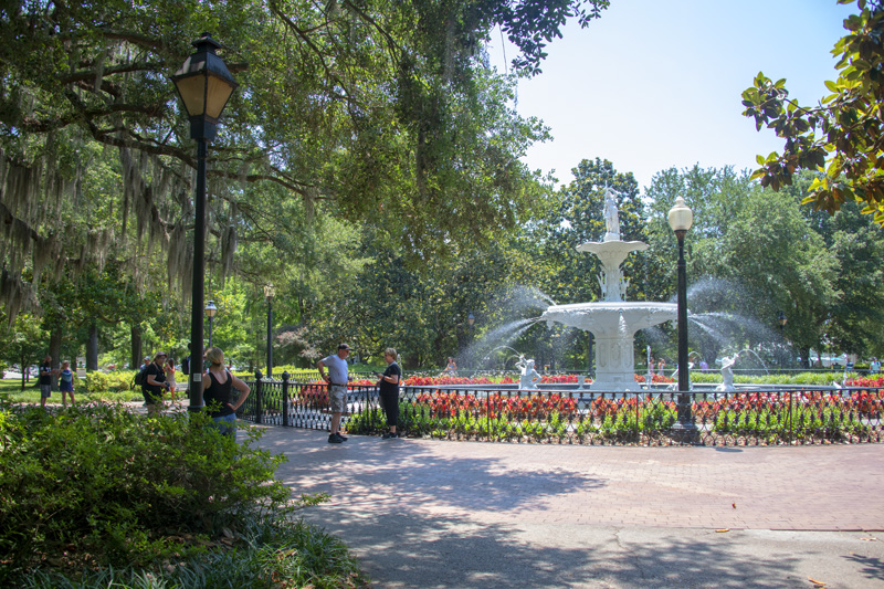 people enjoying a park with a fountain, one of the things to do in Savannah