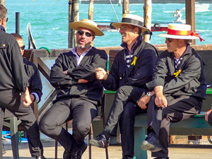 men with hats talking in one of the best places to visit in Venice