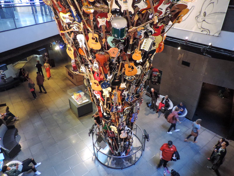 people looking at a museum exhibit of musical instruments - one of the things to do in Seattle