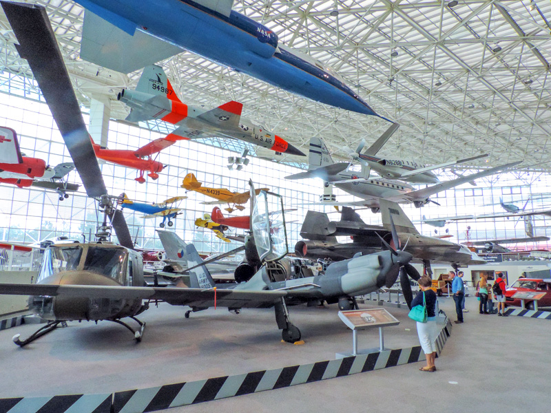large planes hanging in an airplane museum