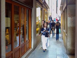 a woman walking down a narrow lane