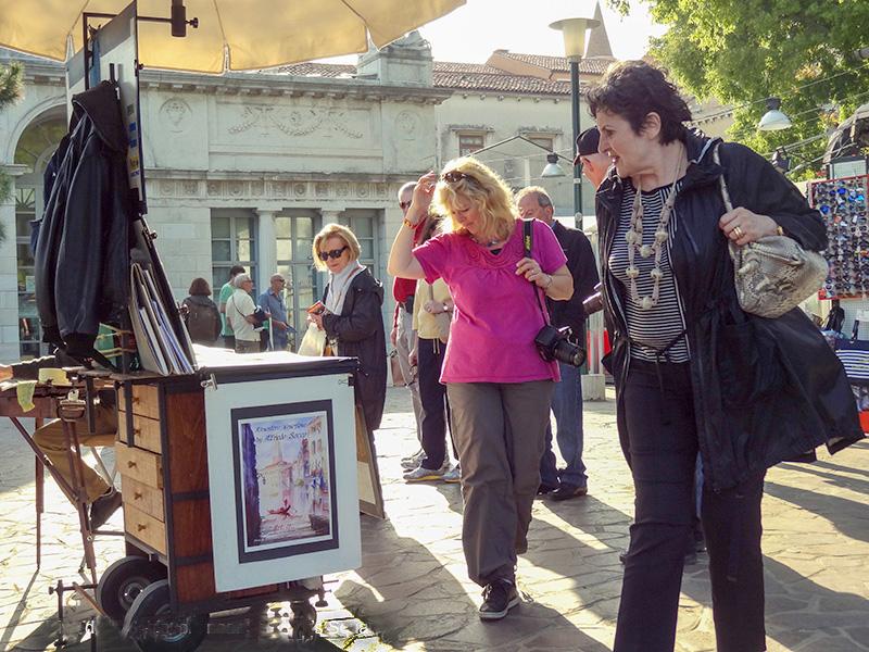 women in an outdoor art market