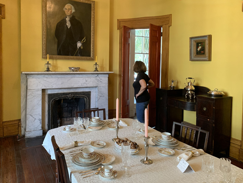 a woman visiting a historical house, one of the things to do in Savannah