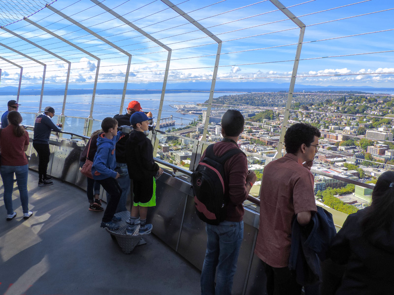people looking out from the space needle - one of the things to do in Seattle