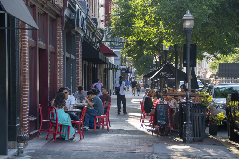 people dining at a sidewalk cafe