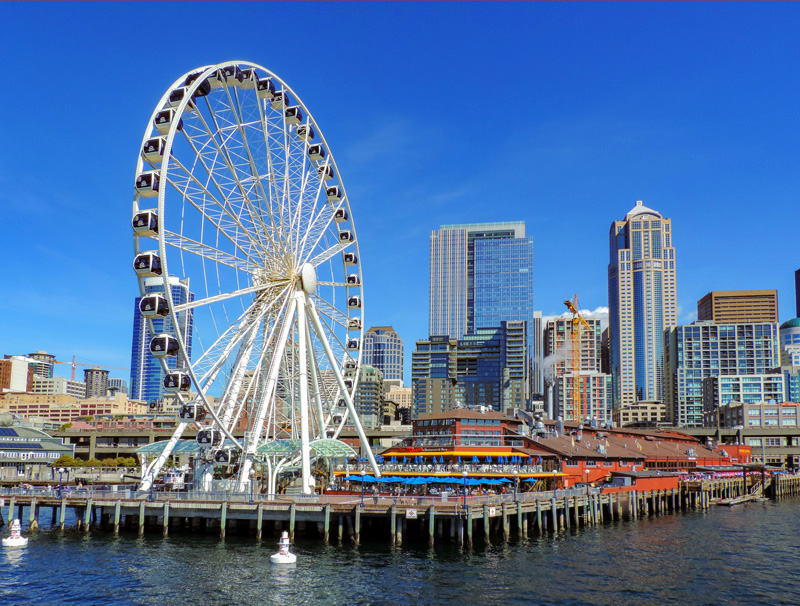 visiting a pier with a ferris wheel - one of the things to do in Seattle