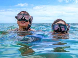 people snorkeling on a Galapagos cruise vacation