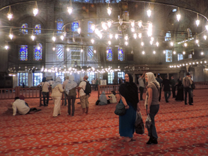 people visiting a mosque, one of the things to do in Istanbul