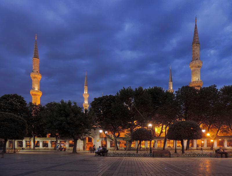 minarets of a mosque illuminated at night