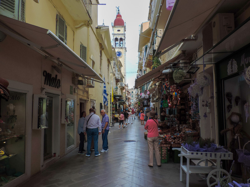 people walking along narrow strret in Old Town - one of the things to do in Corfu