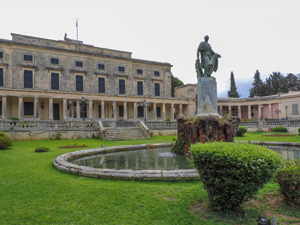 a statue in front of a museum - one of the things to do in Corfu
