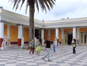 people walking about a palace during the best time to visit Corfu