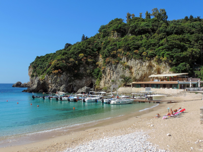 people on a beach during the best time to visit Corfu