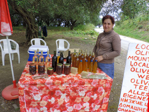 a woman at her roadside stand during teh best time to visit Corfu