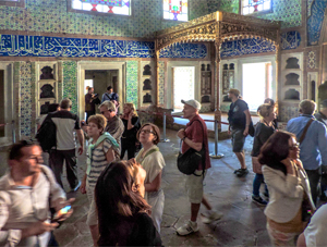 people visiting a room covered with tiles, one of the things to do in Istanbul