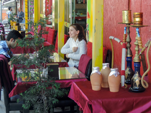 people sitting in a cafe with hookas