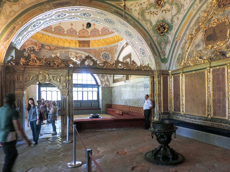 people in an ornate room in a palace, one of the things to do in Istanbul