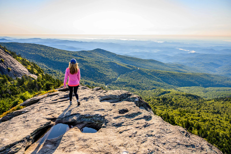 a young woman looking out at the mountains in the North Carolina High Country