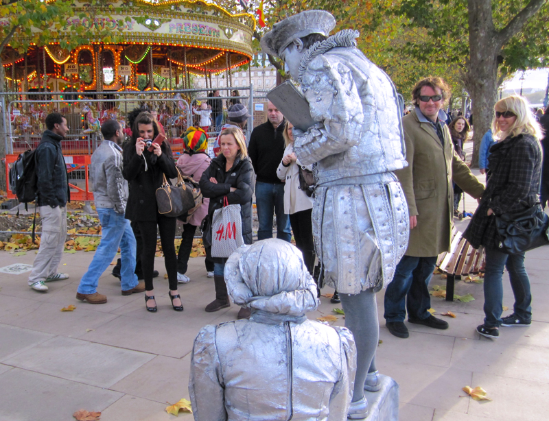 people around a group of mimes