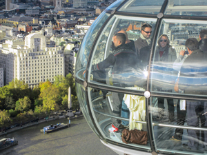 people in a capsule looking at a city
